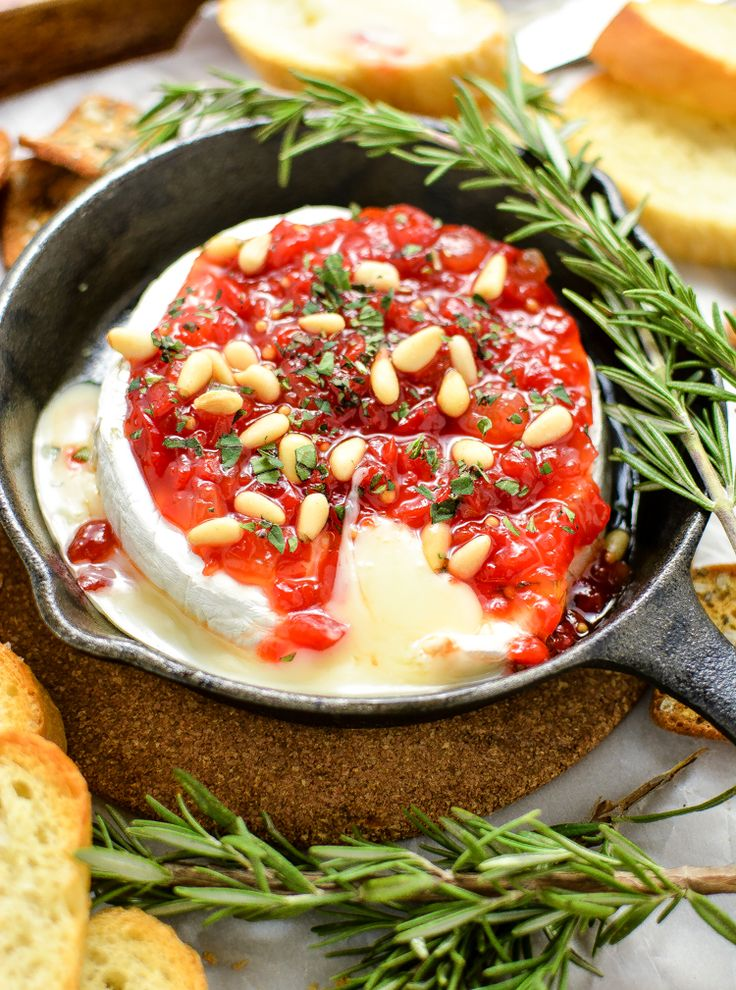 A delicious holiday themed jam, this Baked Brie with Sweet Red Pepper Jam is sure to please the palate at this year's holiday parties.