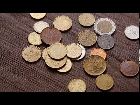 Euro Coins and Bitcoins Are Falling on the Table (Stock Footage)