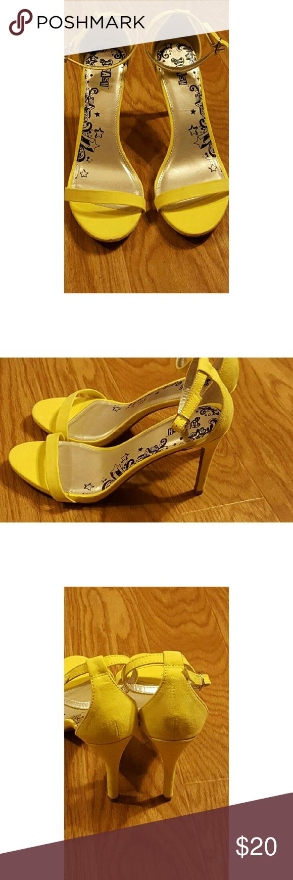 Yellow strappy heels Bright yellow strappy heels. Purchased but never worn. Shoes Heels