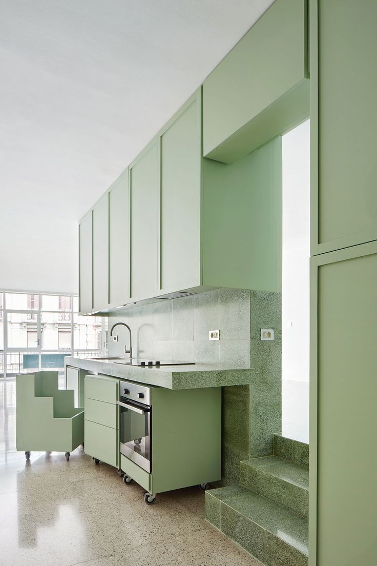 Refurbishment of a Flat on the Casanova Street by Arquitectura G | Yellowtrace. Compare with the picture of a 1920s German kitchen.