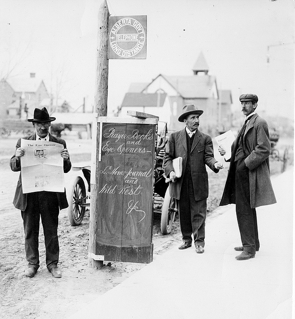 Men handing around a small news stand in downtown Lethbridge, Alberta, c.1910-1912. #vintage #Canada #Edwardian #streets