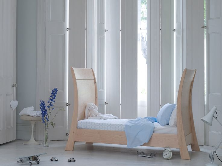 With its sleek curves, the Arcadia sleigh cot bed exudes modern yet timeless elegance. Crafted using the finest solid wood and veneers, it is designed for children from birth to around six. Featuring exquisite design details, concealed hardware to operate the cot gate, and adjustable, secure mattress-height positions, the Arcadia cot can be transformed from a cot to a toddler bed and then to a day-bed. www.Bambizi.co.uk