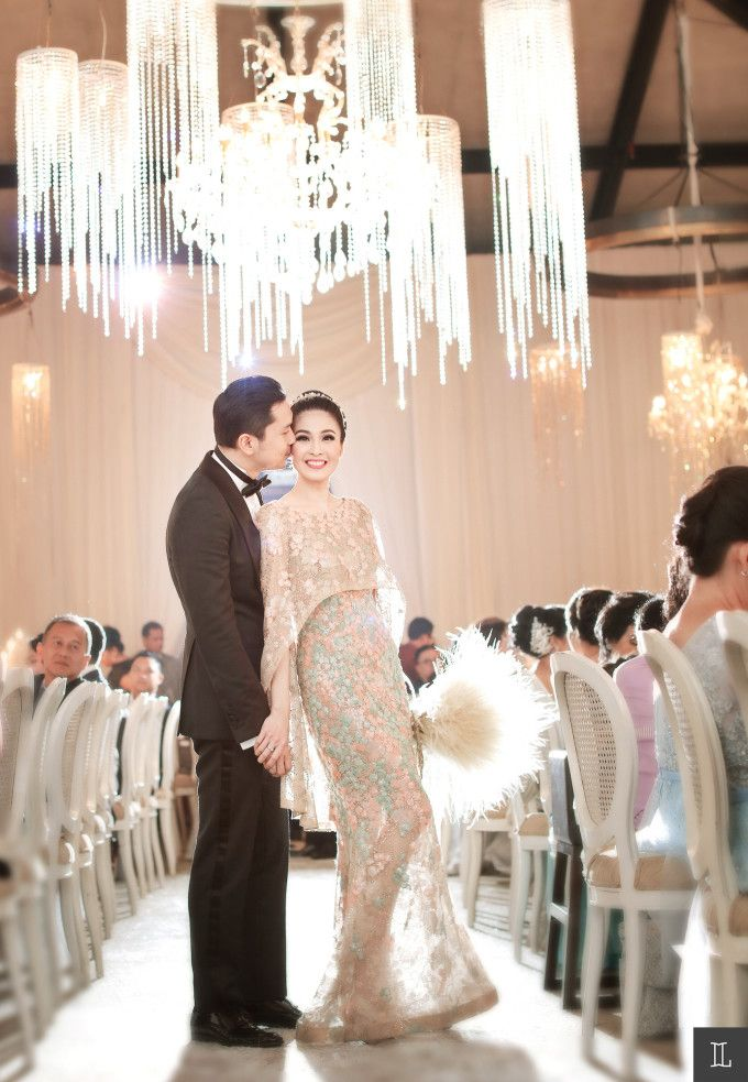 Wedding dress with cape | Sandra Dewi And Harvey Moeis' Dreamy Wedding In Jakarta | http://www.bridestory.com/blog/sandra-dewi-and-harvey-moeis-dreamy-wedding-in-jakarta