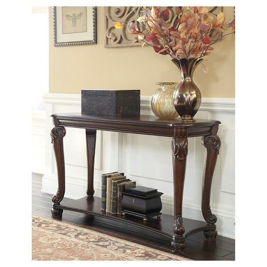 Curvaceously beautiful, this sofa table takes a lovely turn on traditional style. Ornate bun feet, serpentine legs and shapely bottom shelf provide a high-end look.  Signature Design by Ashley is a registered trademark of Ashley Furniture Industries, Inc.
