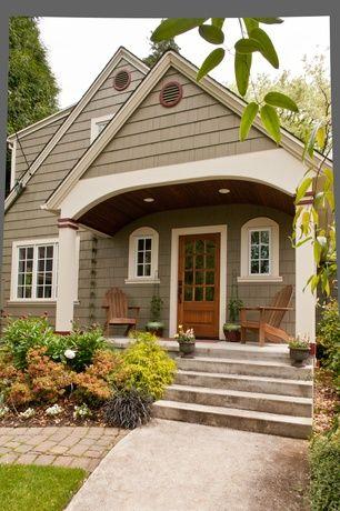 Craftsman Front Door with exterior brick floors, Arched window, Glass panel door, Pathway, Vista adirondack chair