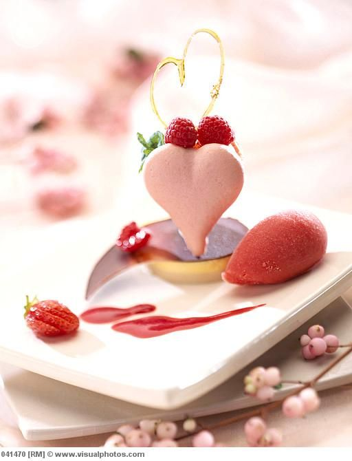Heart shaped macaron with berries and sorbet
