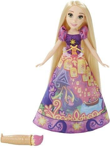 Met deze pop kun je urenlang spelen. Dit keer is de pop gekleed in de jurk van Rapunzel. Deze kunststof popo is 32 centimeter hoog en gebaseerd op het figuur uit de populaire Disney-film. De pop is geschikt voor kinderen vanaf drie jaar.   Afmeting: 321x76x203 mm - Fashion Princess magische jurk: Rapunzel