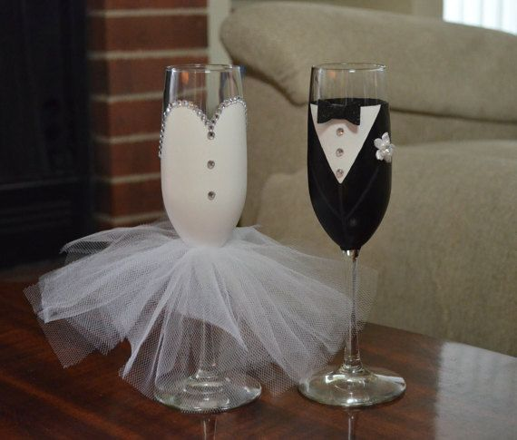 This custom Bride and Groom Set includes two 12 oz champagne glasses. This will make a great bridal shower or engagement gift. Or use it at