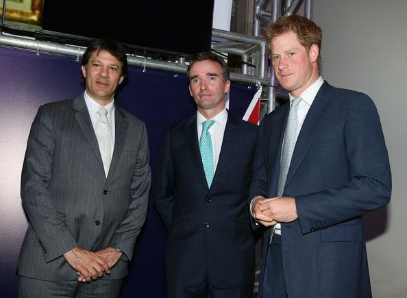 Prince Harry with British Ambassador to Brazil Alex Ellis (L) and Mayor of Sao Paulo Fernando Haddad as he attends a GREAT Britain reception on June 25, 2014 in Sao Paulo Brazil.