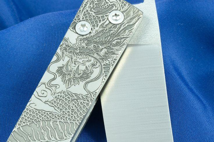 Titanium, N690, laser engraving. Drawing by Mark Šidlovský.