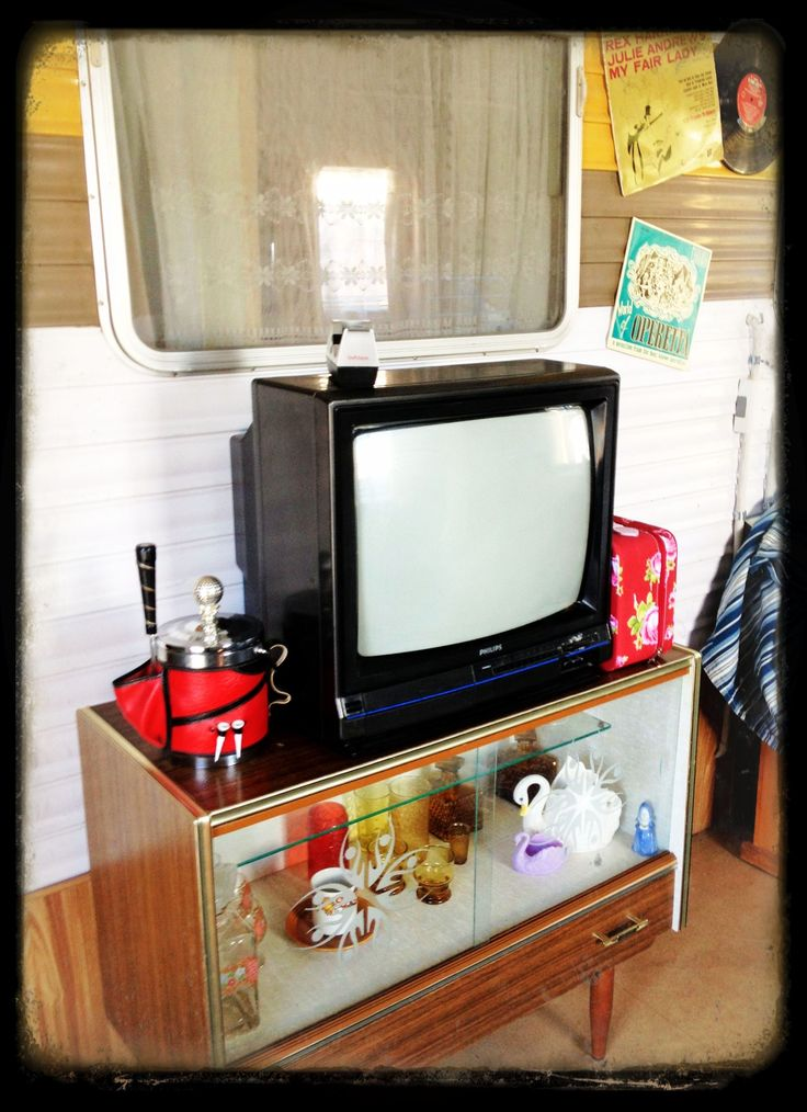 Repurposed 1970s cabinet makes a great TV stand.