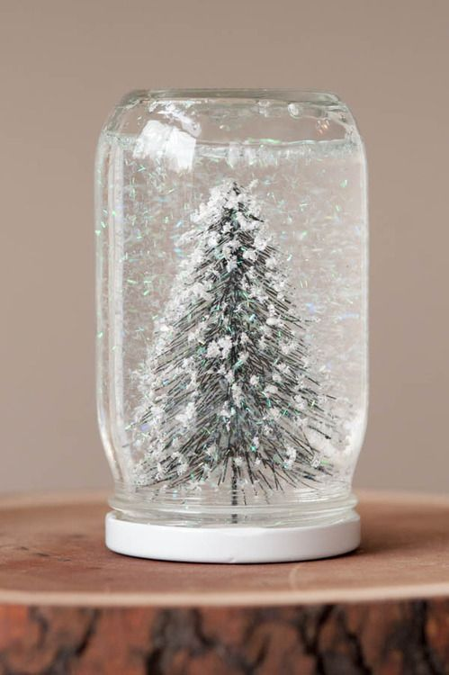 Homemade Snow globes- What You'll Need Mason jar Distilled water Liquid glycerin Glitter Craft trees (or other figurines) Epoxy How To Make It 1. Attach your trees to the lid of the jar using the epoxy and let them dry overnight. 2. The following day, fill the mason jar with distilled water. 3. Add a few drops of the liquid glycerin and then drop in the glitter. 4. Screw the cap on and shake it up to give your homemade snow globe a test drive!