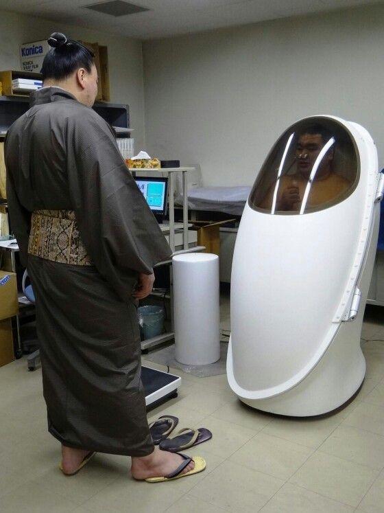 sumo wrestler in an oxygen capsule