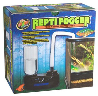 """Zoo Med Repti Fogger Terrarium Humidifier is a Compact Ultrasonic Humidifying Fogger with adjustable fog output control to help increase your tank's humidity. Create a tropical rainforest in your terrarium using this product! Dramatic cool mist increases animal comfort, relative humidity, and visual appeal. The Repti Fogger can be used to increase the overall humidity level in smaller terrariums, or to create a humid """"micro climate """" in larger terrariums."""