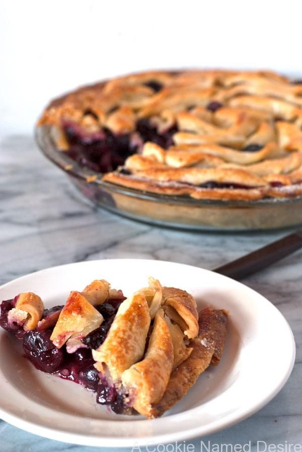 A simple, flavorful bourbon cherry apple pie that will warm your heart and fill you with happiness. This homey pie is easy to make with a flaky crust recipe