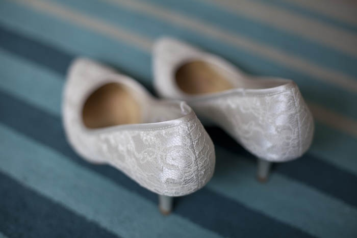 White bridal shoes view from the side