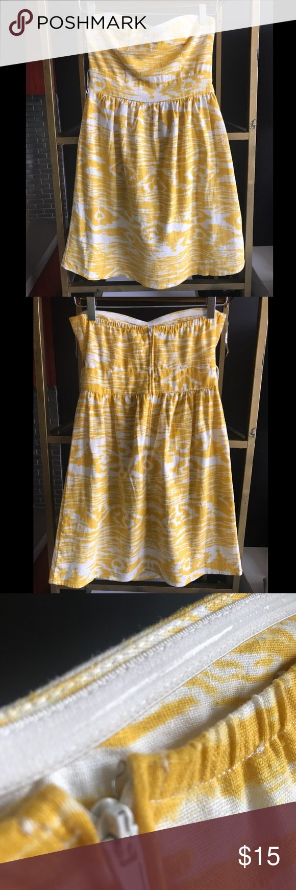The cutest yellow okay strapless dress So cute, so fun... such a pretty sunny color in a great ikat pattern. works well for hot summer days and throw a little jacket or white cardigan over it to take you in to fall. Great fitted top with subtle sweetheart neck, clear grip band inside the top edge keeps dress up without any yanking or slipping, zips at back.  Hits just above knee. Lined in front. Fit was tight enough on me that I was able to go braless because of the lining. Worn only a…