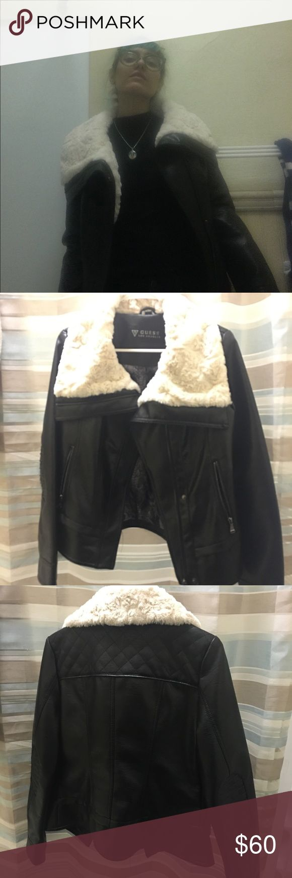 Guess brand fur leather jacket Guess jacket medium. Black faux leather with white/creme colour very very soft faux fur collar. Looks amazing on. You can zipper all the way up and fold the fur over and keeps you warm (as seen in last photo). Guess Jackets & Coats