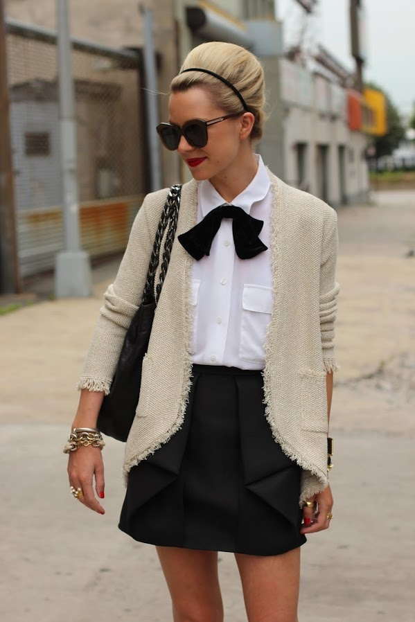 Skirt: Tibi. Top: Equipment. Shoes: Stuart Weitzman. Purse: Chanel. Sunglasses: Karen Walker 'Number One'. Lips: MAC 'Ruby Woo'. Nails: Essie 'Lollipop'. Bow: ASOS. Jewelry: David Yurman, Kate Spade, Jcrew, Stella, Pomelatto, YSL. Cardi: Zara (current).   june