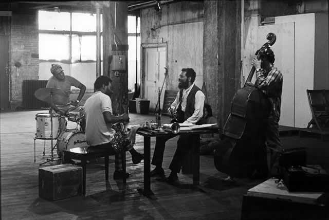 Ed Blackwell, Dewey Redman, Ornette Coleman, Charlie Haden, May 1971. ©Val Wilmer/CTSIMAGES. All rights reserved.