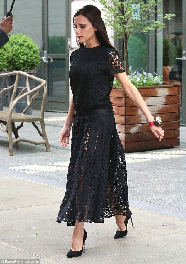 Finishing touches: Conventional black stiletto heels completed the look as Victoria hurrie...