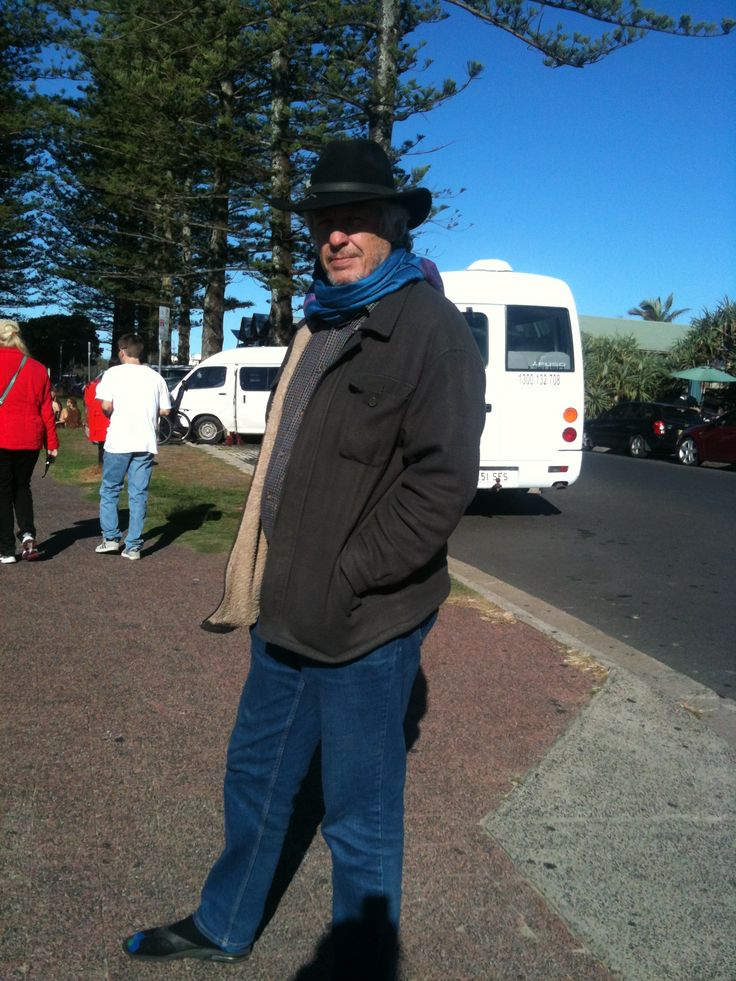Peter seemingly dressed appropriately For Byron Bay as others were swimming