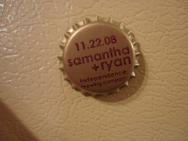 Neat idea!! Bottle cap wedding favors with a magnet on the back. we could totally make these!!