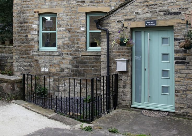 Milano composite door in chartwell green with ES 3 door handle and key only security locking system and integrated side panel.