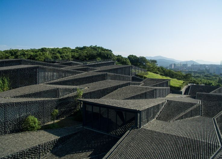 "Japanese firm Kengo Kuma creates sprawling ""village"" of folk-art galleries for China Academy of Arts."
