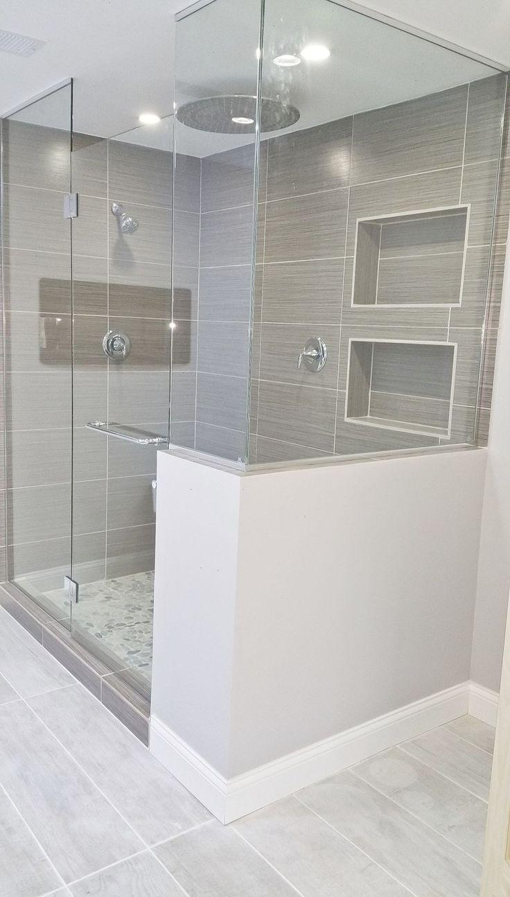 Love the grey slate like tile in shower