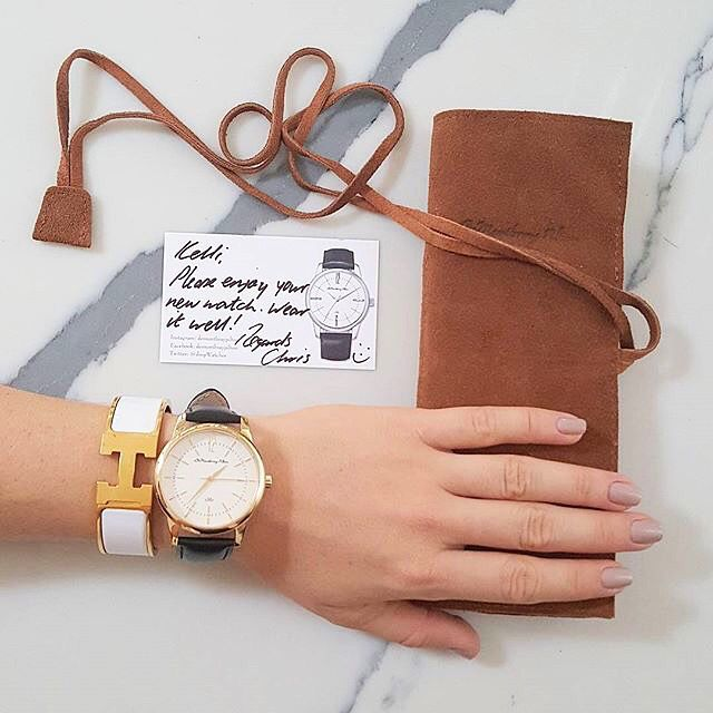 Happy Brisbane customer with her gold watch and leather travel case