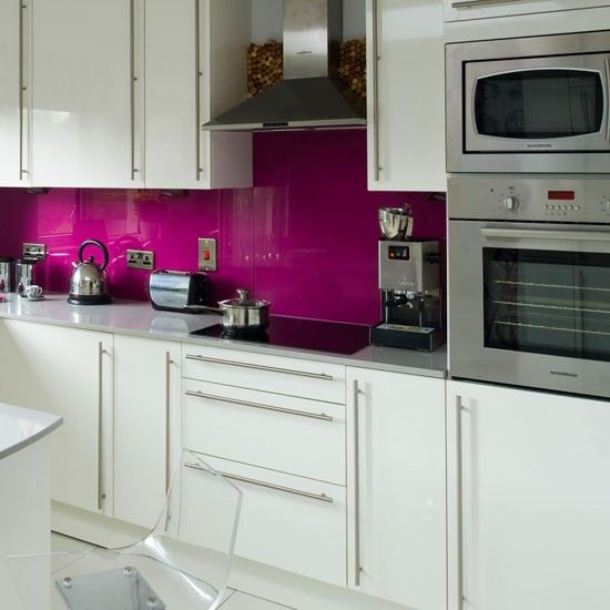 Not necessarily sure about the colour, but glass splashbacks can be a really effective way of injecting some wow factor into an otherwise neutral kitchen.  They are also extremely practical.  Try Deco Glaze for a great range of colours.
