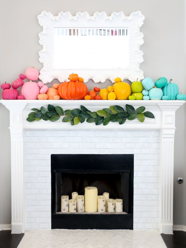 Remember all those bright colorful pumpkins from yesterday? Well, I painted a few extra and created the absolute best fall/halloween mantel...