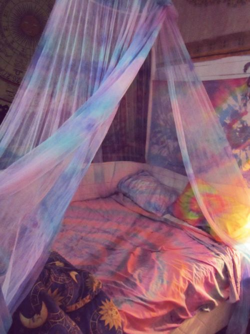 Tie Dye Bed. I love the way the bed is set up though. With the draped material and the pillows along the edges and against the wall. I could do this with my bed.