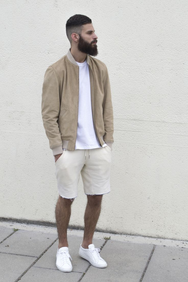 Shop this look on Lookastic:  https://lookastic.com/men/looks/tan-bomber-jacket-white-crew-neck-t-shirt-beige-shorts-white-low-top-sneakers/11895  — Tan Suede Bomber Jacket  — White Crew-neck T-shirt  — Beige Shorts  — White Low Top Sneakers