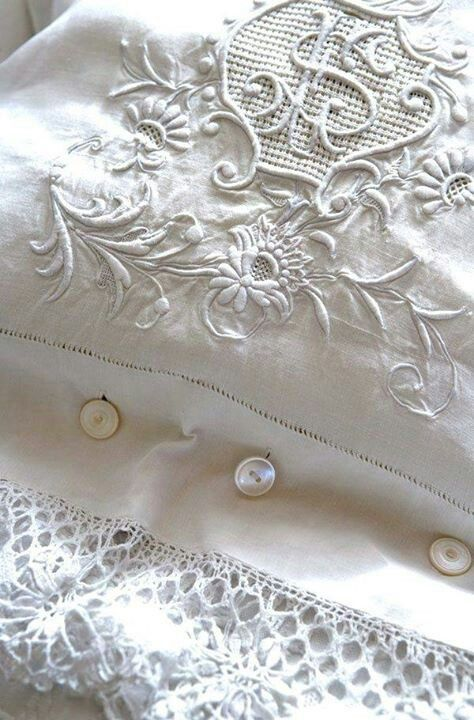 White embroidery on white linen. Pillow cases close with tint Pearl buttons.