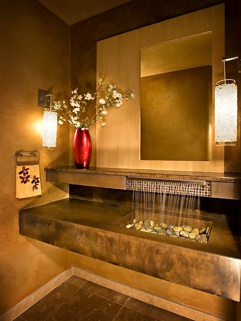 Probably the coolest bathroom sink I've ever seen! Who wouldn't want to wash their hands with this sink?