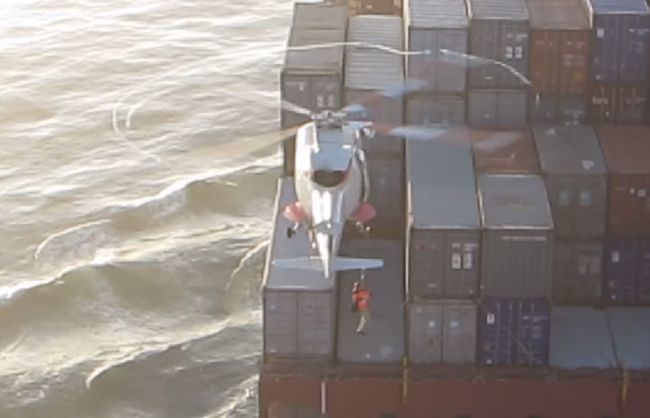 Ship pilot landing from helicopter..