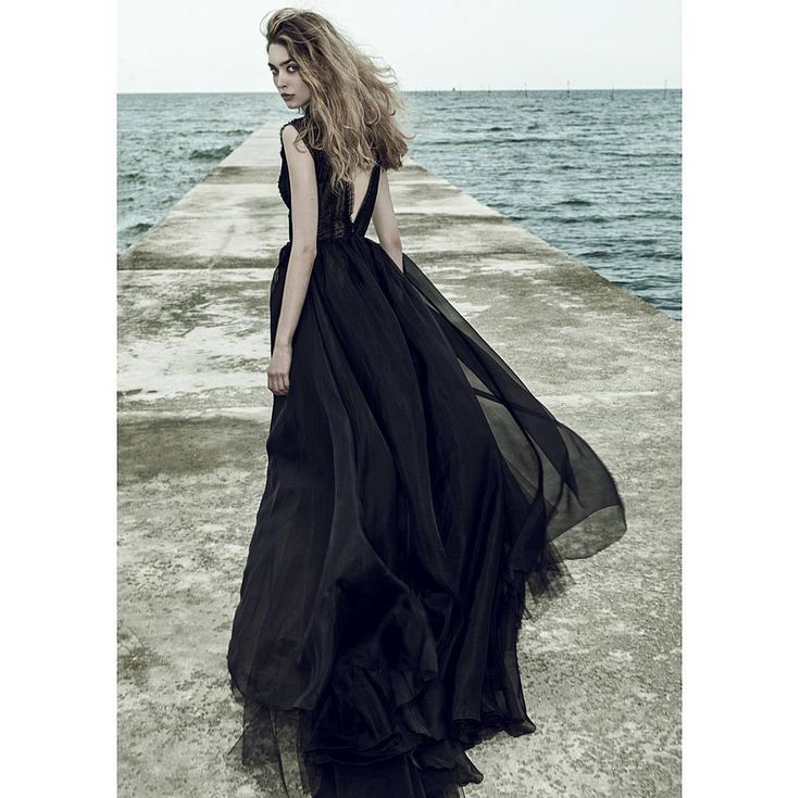 Ersa Atelier couture evening gown 2017.  Cut-off from the conventional and hauntingly beautiful, she lures us with a breathtaking look worthy of a modern-day goddess of style. Monuriki evening couture black dress.