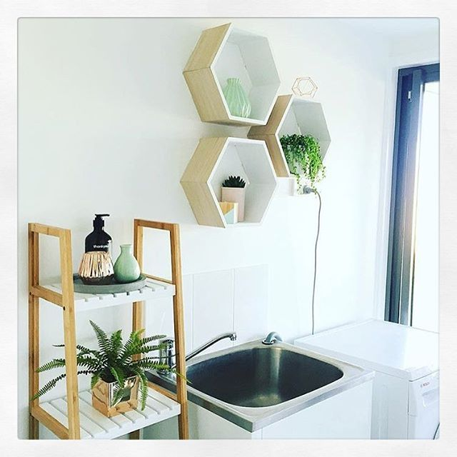 Laundry inspo from #bfree_style featuring Kmart hexagon shelves and ladder…