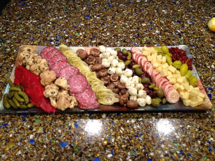 Fun Antipasto platter with marinated veggies, meats and cheeses.  Crowd pleaser!