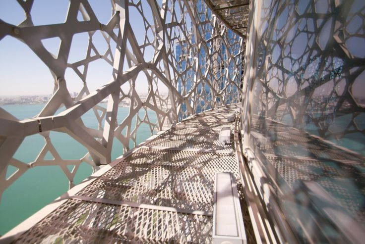 Complicated pattern+ Reflective material = Dispersal, distortion and density. - Jean Nouvel in Doha