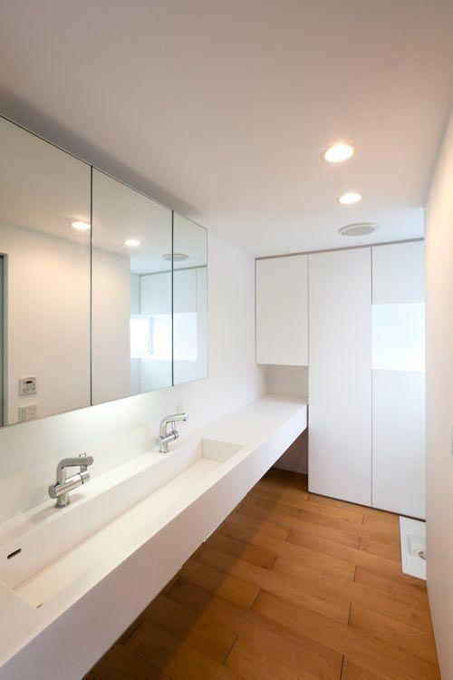 Long sink in minimalistic bathroom