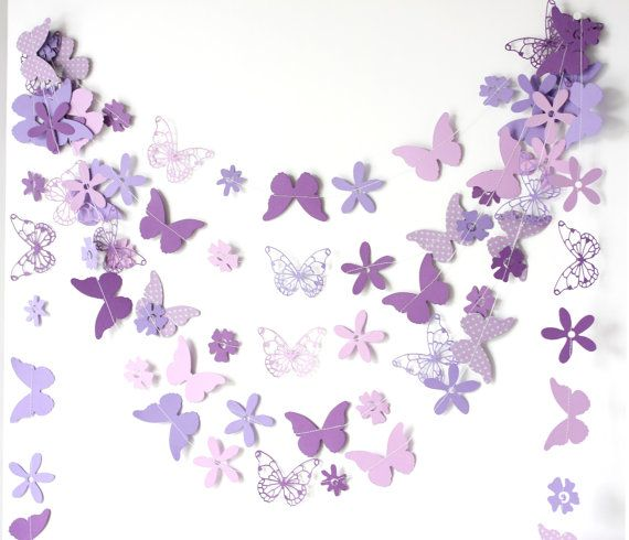 13 feet (does not include thread left for hanging) delicate paper garland in purple and lavender colors.  colorful shapes,butterflies, flowers are