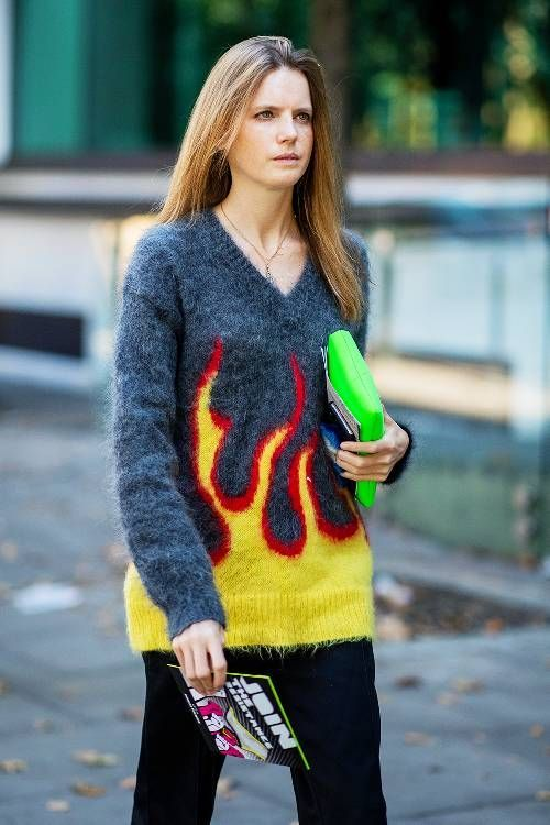 0f39bbfdc67 Best statement jumpers  blogger wearing Prada flame knit