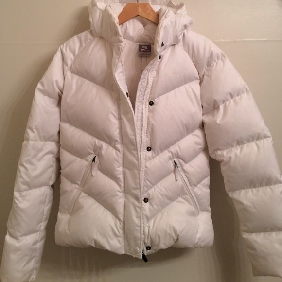 Nike winter jacket Women's small Nike puffer winter jacket. Retails $200. Worn once. Polyester body and down feather fill. Detachable hood. Good condition, sleeves got a little dirty as shown in picture 3 but I'm sure it will come out in the wash. Can be machine washed. Open to offers. Nike Jackets & Coats Puffers