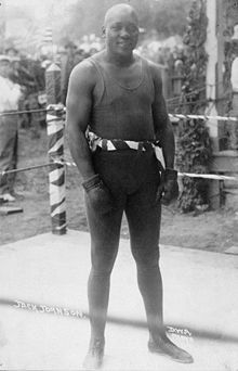"""""""Jack Johnson (born March 31, 1878) was the first African American heavyweight boxing champion. The 1970 film The Great White Hope and the 2005 Ken Burns documentary Unforgivable Blackness are accounts of his life."""""""