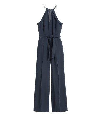 Dark blue. Jumpsuit in woven fabric with a V-neck and narrow-cut top section…