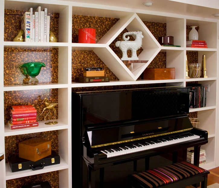 piano framed in bookcase