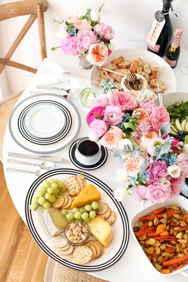 Champagne brunch, complete with cheese platter and florals to die for.